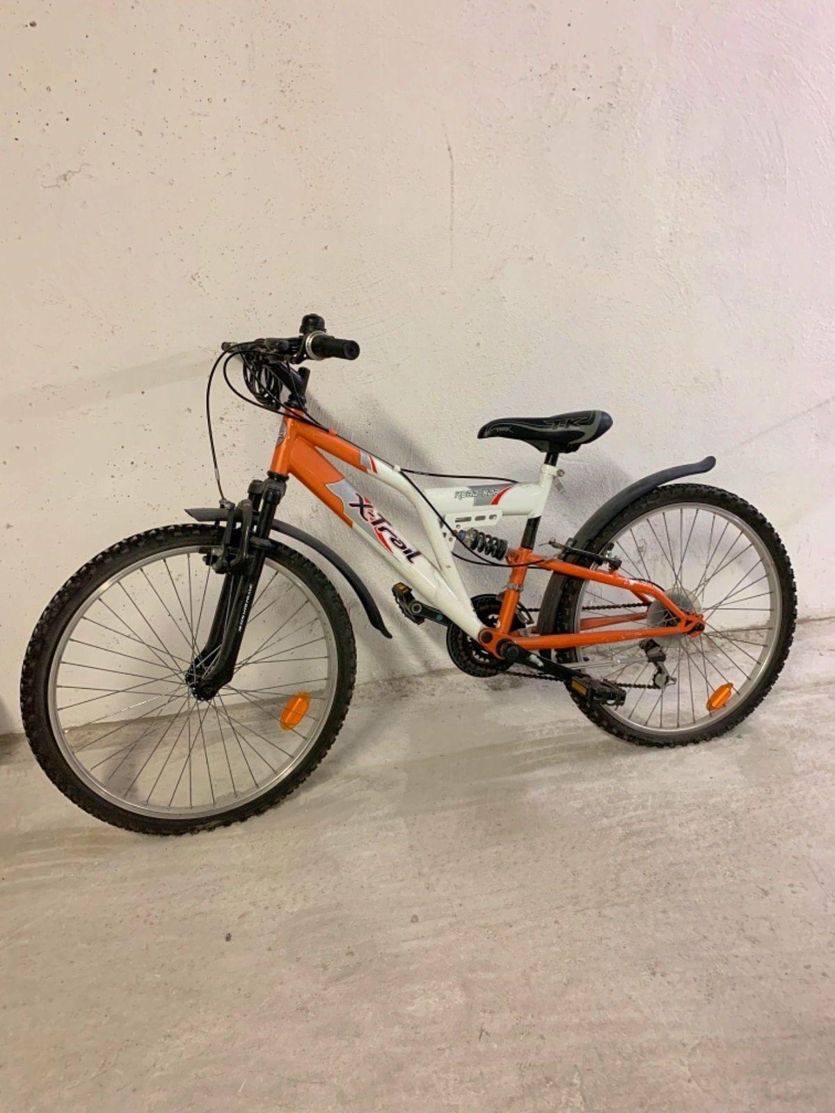 Vélo enfant 10-12ans